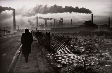 A man walks towards the   chimneys of the steel foundry in West Hartlepool, Don McCullin